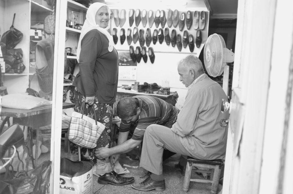 Turkish woman-at-shoeshop
